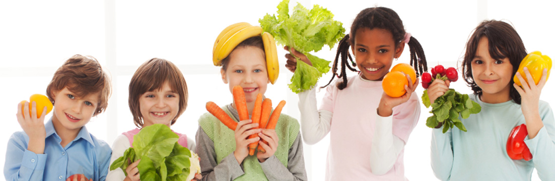children posing with food